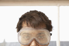 Close-Up Of Man Wearing Protective Goggles Royalty Free Stock Images