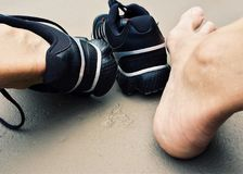 Close-up of Man Wearing Shoes Stock Photo