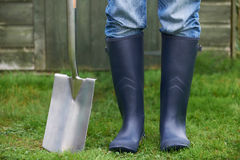 Close Up Of Man Wearing Wellingtons Holding Garden Spade Royalty Free Stock Photo