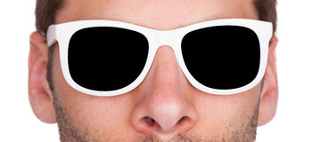 Close-up of a man wearing white sunglasses Royalty Free Stock Images