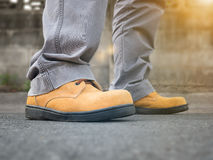 Close up of man wears safety shoes Royalty Free Stock Images
