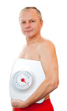 Close-up of a man with weight scale Stock Image