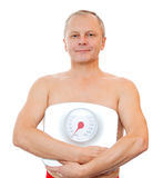 Close-up of a man with weight scale. A man holding measuring instrument  isolated on white Stock Image