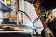 Close up man weld a metal welding machine Royalty Free Stock Photos