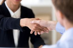 Close up man and woman shaking hands, getting acquaintance, agre. Close up men and women shaking hands, getting acquaintance, agreement, greeting at meeting in royalty free stock images