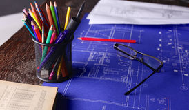 Close up man working of Architect sketching a construction project on his plane project at site construction work Royalty Free Stock Photography