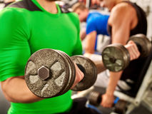 Close up of man working his arms with dumbbells at Royalty Free Stock Photos