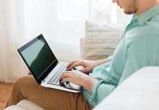 Close up of man working with laptop at home Royalty Free Stock Images