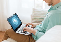 Close up of man working with laptop at home Stock Photography