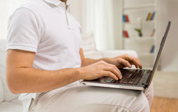 Close up of man working with laptop at home Royalty Free Stock Photos