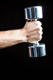 Close-up of of man working out with dumbbell Stock Photo