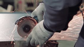 Close-up of man working with special saw and metal. stock footage