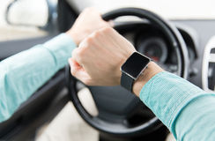 Close up of man with wristwatch driving car Royalty Free Stock Photos