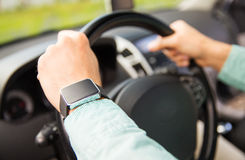 Close up of man with wristwatch driving car Stock Images