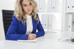 Close up of manager in blue blazer who is taking notes Stock Photography