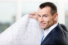 Close up of manager with sketch. Concept of successful construction Royalty Free Stock Images