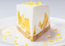 Close up of mango cream pie with peeled split mung bean on white Royalty Free Stock Photography
