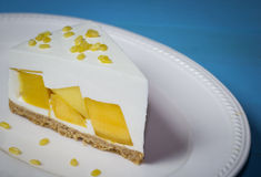 Close up of mango cream pie with peeled split mung bean on white Stock Photography
