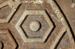 Close-up manhole cover. A close-up shot of the steel patterns of a manhole cover Royalty Free Stock Images