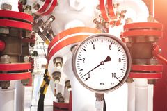 Close up of manometer, pipe, flow meter, water pumps and valves of heating system in a boiler room.  royalty free stock images