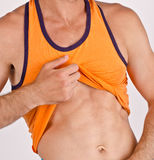 Close up on man's abs. Stock Photography