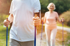 Close up of mans hand holding walking poles Stock Photo