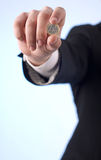 A man with one euro coin. Close-up of mans hand with one euro coin Stock Image