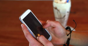 Close-up of mans hand using mobile phone. In pub stock video footage