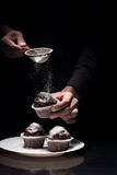Close up of mans hands cooking the cupcakes Stock Photography