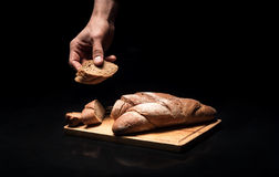 Close up of mans hands holding the baguette Royalty Free Stock Photography