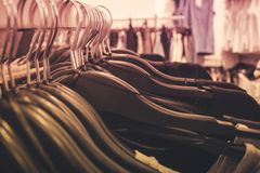 Close up of many clothes on hangers in a clothing shop.  royalty free stock image