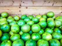 Close up of many green limes on the shel. F Royalty Free Stock Photo