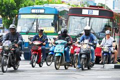 Close-up of many motorbikes and buses at the daily rush hour royalty free stock photo