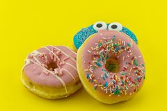 Multicolored funny donuts Stock Image