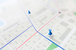 Close up of map or city plan with pin. Cartography, location and navigation concept - close up of map or city plan with pin Stock Photo