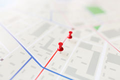Close up of map or city plan with pin. Cartography, location and navigation concept - close up of map or city plan with pin Stock Images