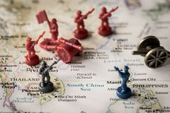 Close up of map of the South China Sea with representing conflict. Macro close up of toy soldiers on a map of the South China Sea representing conflicting Stock Photography