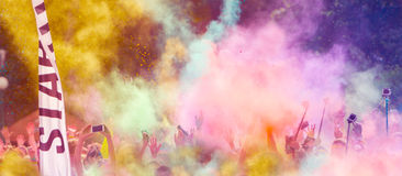 Close-up of marathon runners with colored powder Royalty Free Stock Photos