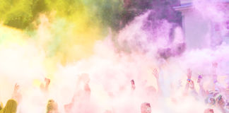 Close-up of marathon runners with colored powder Stock Photography