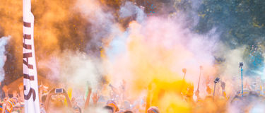 Close-up of marathon runners with colored powder Stock Photos