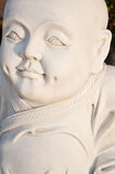 Close up of a marble buddha. A close up of a marble chinese buddha sculpture stock images