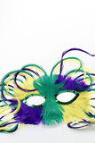 Close up mardi gras mask. Close up of a feathered Mardi gras mask on white background Royalty Free Stock Image