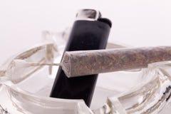Close up of marijuana and smoking paraphernalia Royalty Free Stock Photography