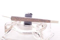 Close up of marijuana and smoking paraphernalia Stock Images