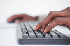 Close up of a masculine hand using a keyboard Royalty Free Stock Image