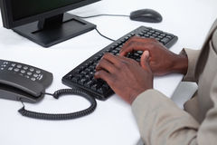 Close up of masculine hands typing with a keyboard Stock Images