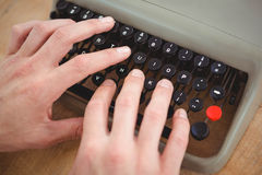 Close up of masculine hands typing on old typewriter Royalty Free Stock Image