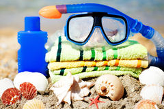 Close up of mask,towel seashells and tube Royalty Free Stock Images