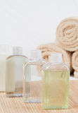 Close up of massage oils and towels Stock Photos