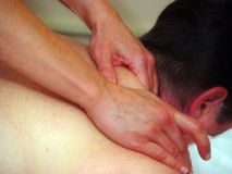 Close up of masseuse's hands Royalty Free Stock Image